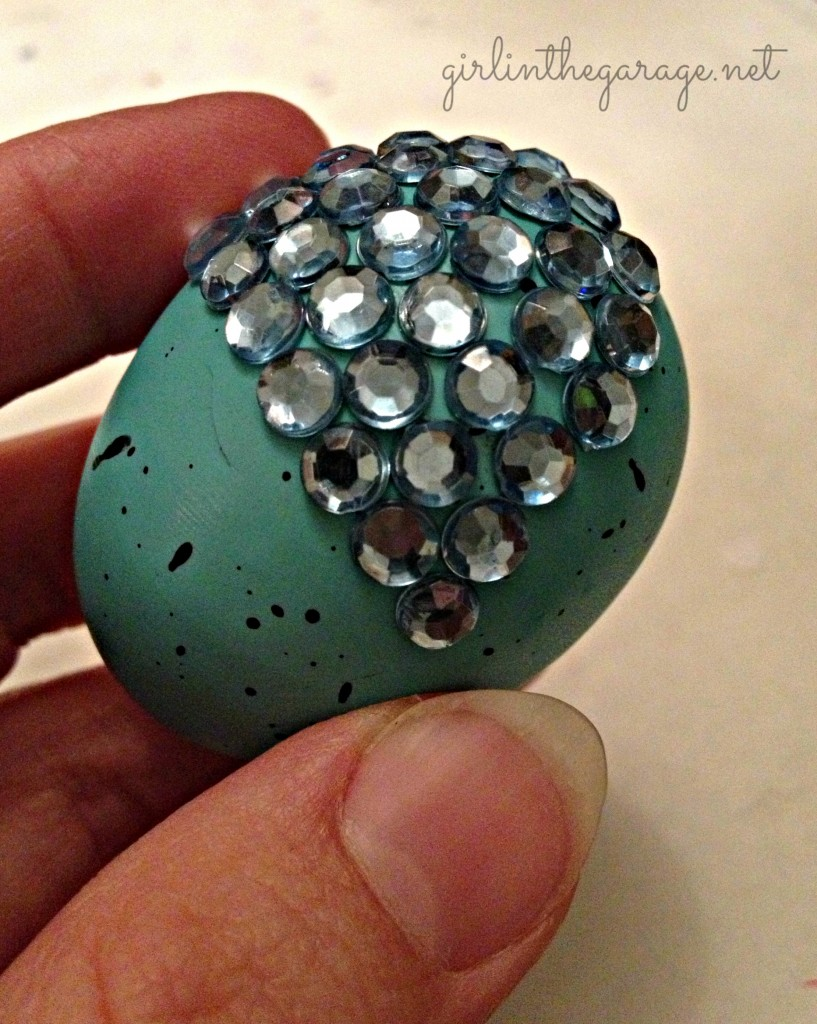 Adding rhinestones to egg. Girl in the Garage