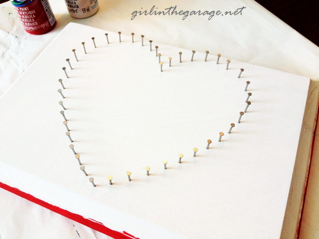 Nails around heart by Girl in the Garage