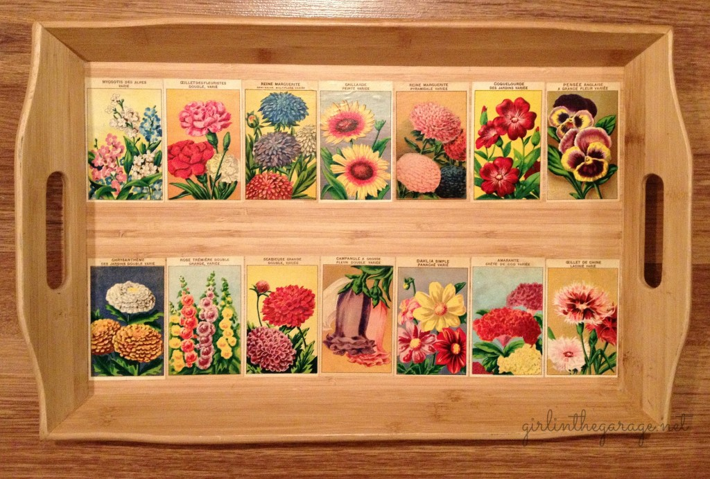 French flower labels decoupaged onto tray. Girl in the Garage