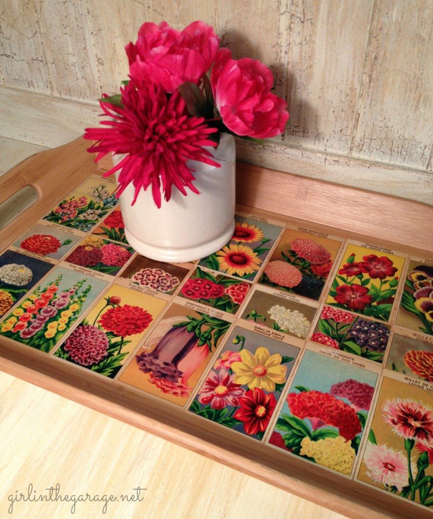 Vintage French flower seed labels decoupaged onto bamboo tray. By Girl in the Garage
