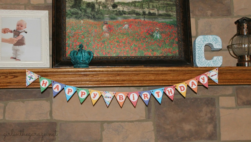 Planes, Trains, and Automobiles Birthday Party by Girl in the Garage & Kiyomi Designs.  (Mini banner on mantle.)