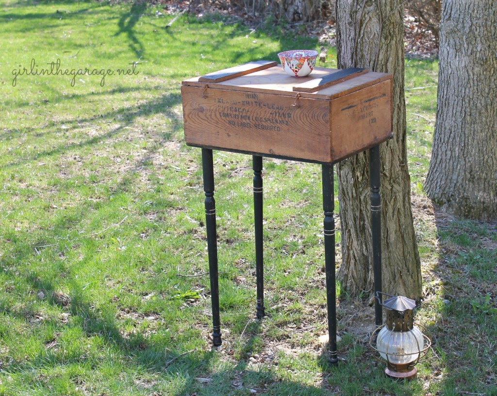 "Upcycled old crate to ""farmhouse chic"" side table by adding legs and paint.  By Girl in the Garage"
