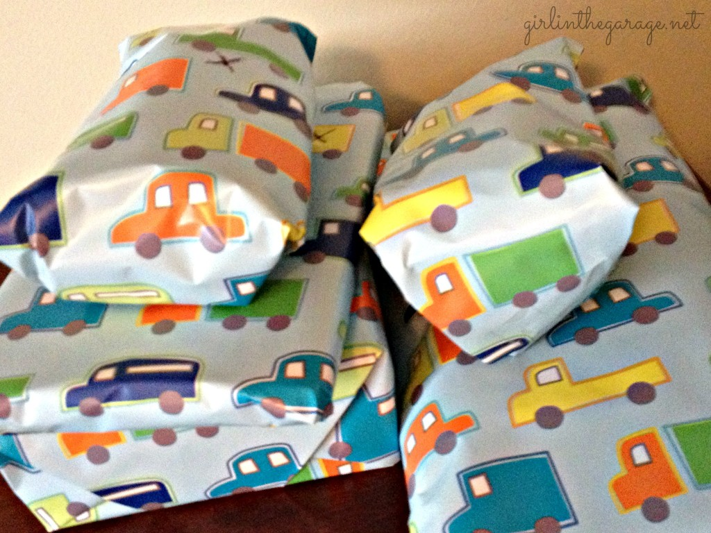 Planes, Trains, and Automobiles Birthday Party by Girl in the Garage & Kiyomi Designs.  Presents in cars/trucks gift wrap.