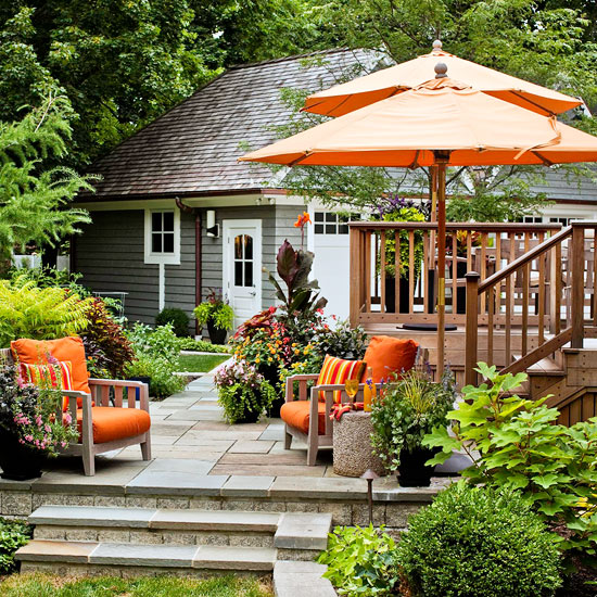 Tiered deck and patio {via Better Homes & Gardens}
