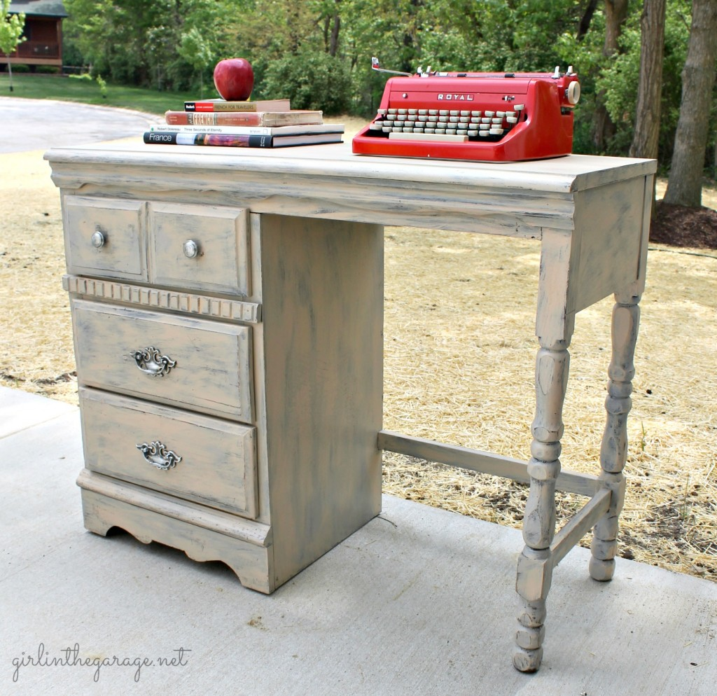 Vintage desk makeover by Girl in the Garage.  An old tattered yard sale desk was repaired and revived into something definitely worthy of bringing inside the house!