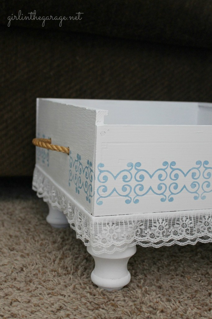 The prettiest little crate makeover.  Great for storing magazines or keeping remotes in one place!