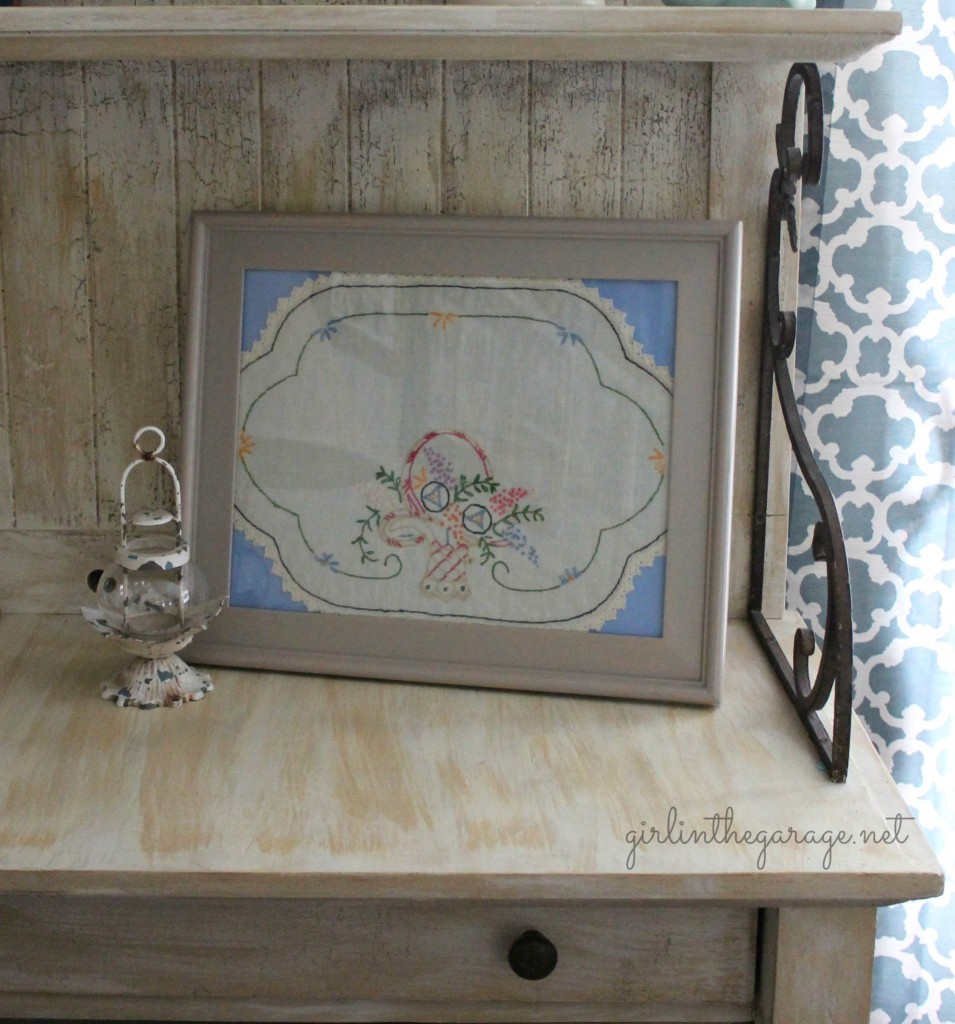 Vintage handkerchief framed as art.
