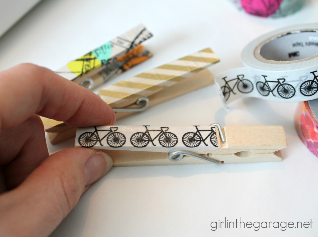 Add some personality to ordinary clips and magnets with washi tape!  girlinthegarage.net