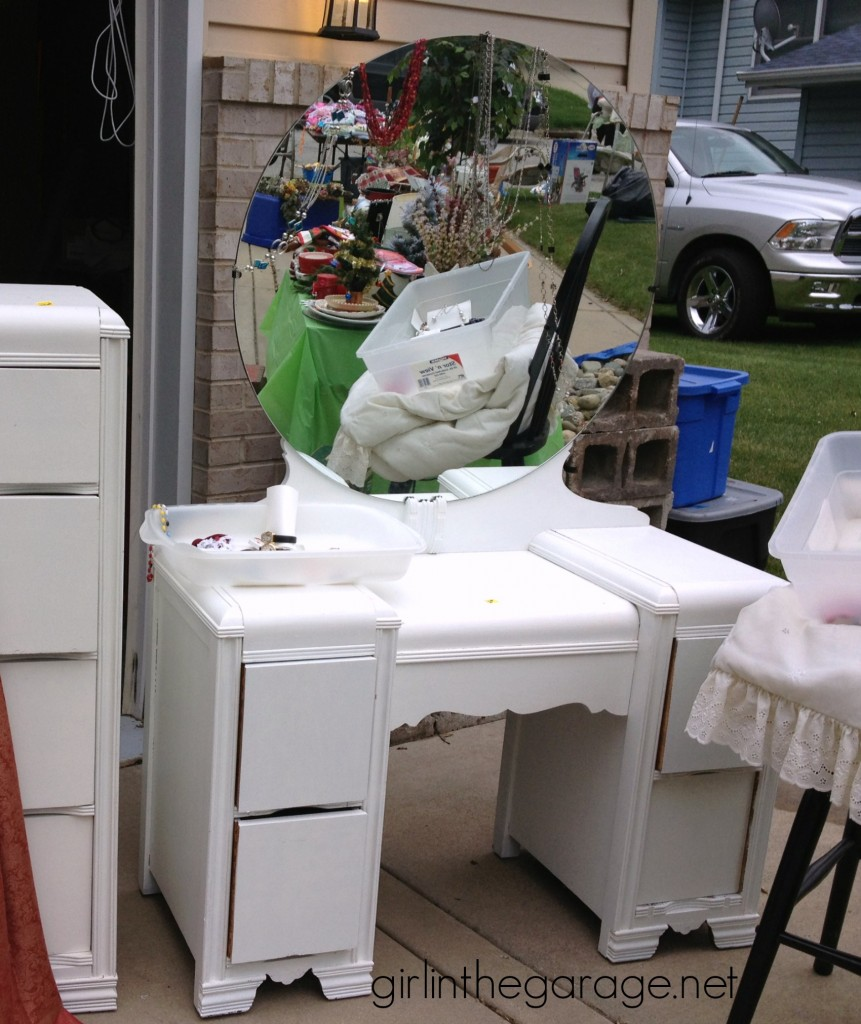 Before:  Bright white and yellow waterfall vanity makeover with Annie Sloan Chalk Paint® and stenciled peekaboo drawers.  girlinthegarage.net