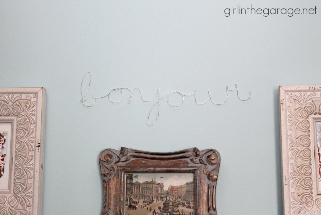 "DIY Wall Art: Framed Paris Prints and Anthropologie-Inspired ""Bonjour"" Wire Script.  girlinthegarage.net"
