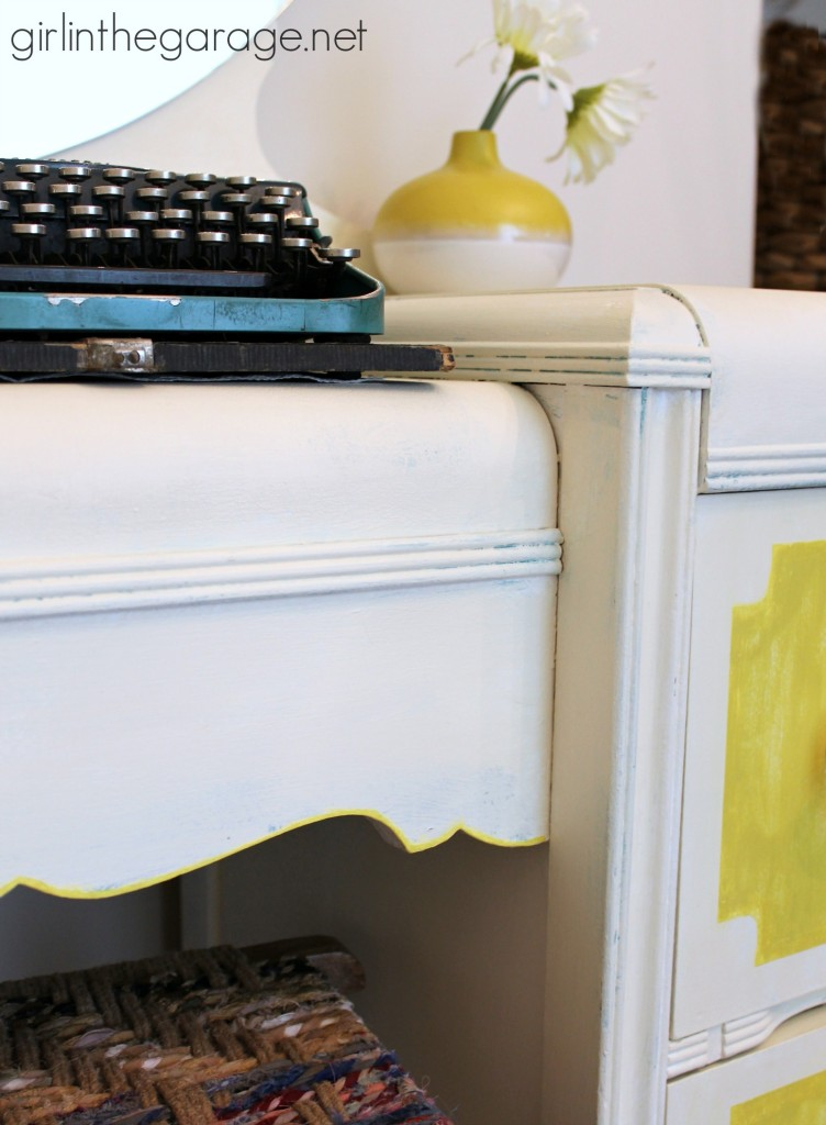 Bright white and yellow waterfall vanity makeover with Annie Sloan Chalk Paint® and stenciled peekaboo drawers.  girlinthegarage.net