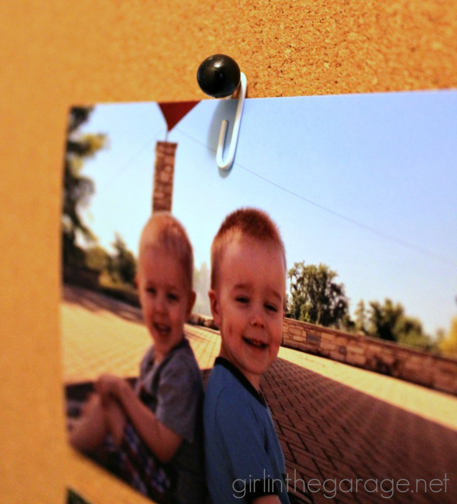 How to hang a photo on a cork board without poking a hole through it!  girlinthegarage.net