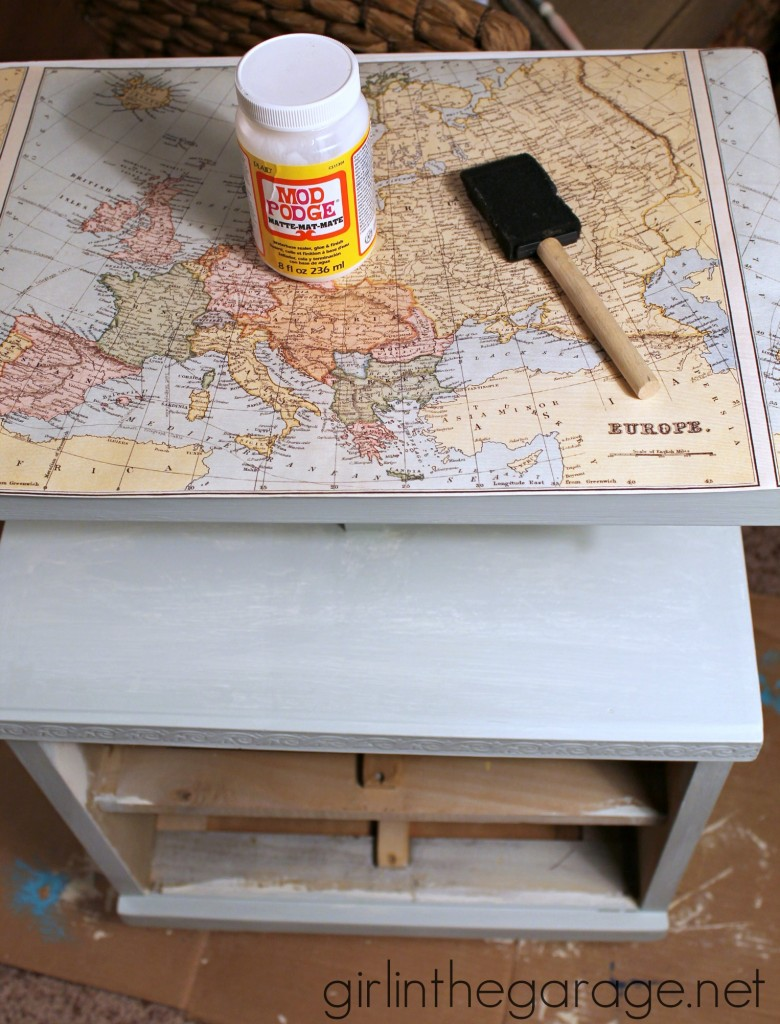 "Decoupaged Map Table: Chalk Paint, Mod Podge, and maps.  ""Travel"" themed furniture makeover day - girlinthegarage.net"
