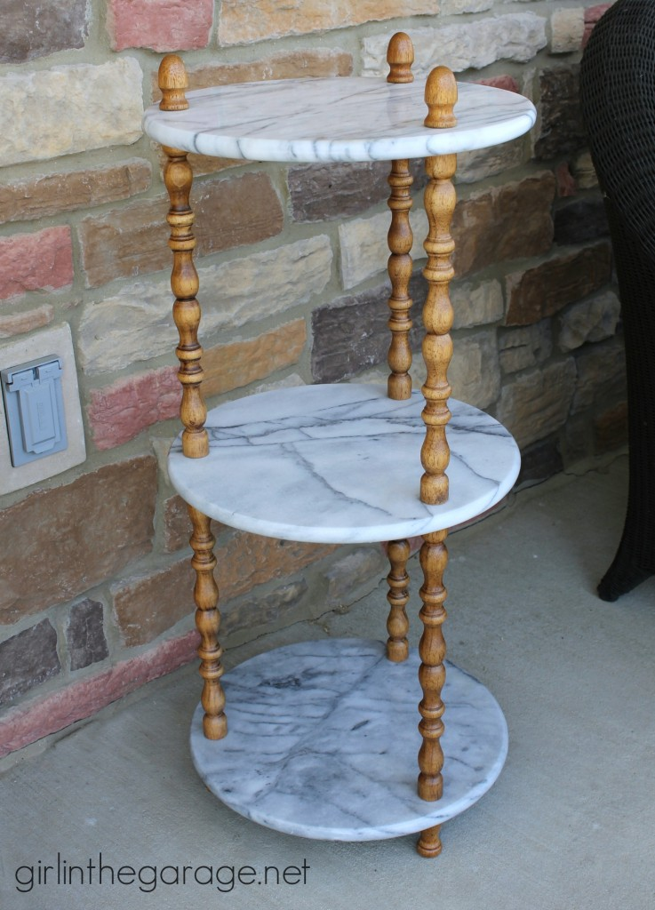 BEFORE: A marble table is updated with Graphite Chalk Paint on wooden spindles.  girlinthegarage.net