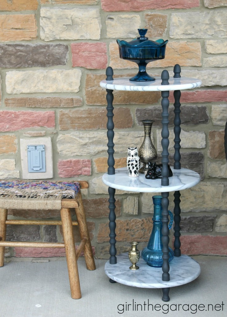 A marble table is updated with Graphite Chalk Paint on wooden spindles.  girlinthegarage.net