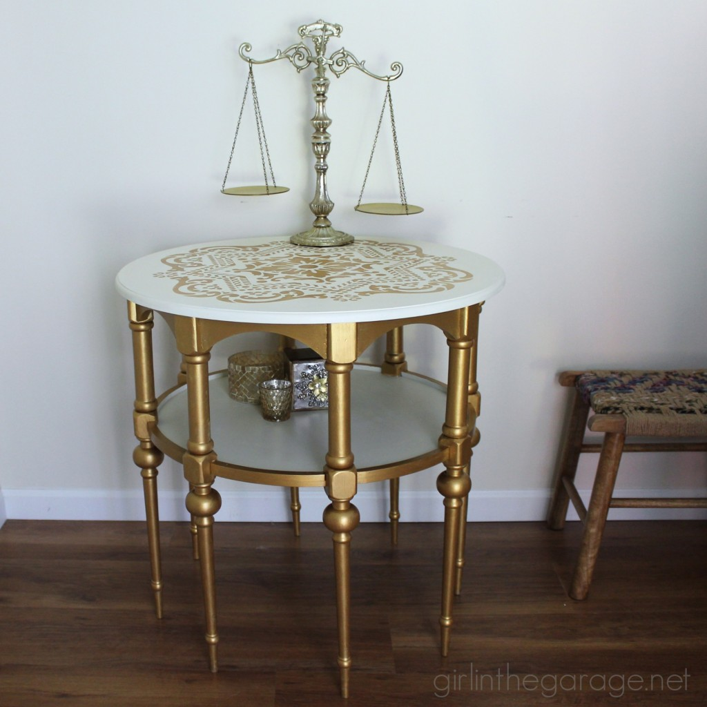 A stunning stenciled table makeover in metallic gold and white for Themed Furniture Makeover Day.   girlinthegarage.net