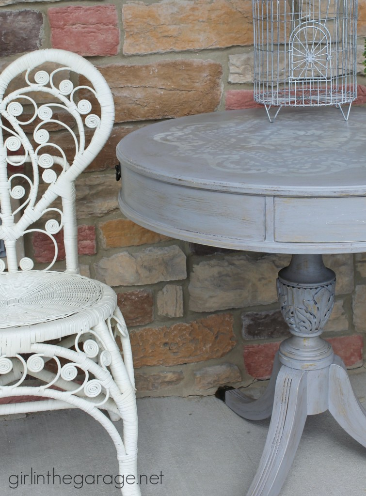 How to update an old table with a fabulous stencil and layered paint technique.  girlinthegarage.net