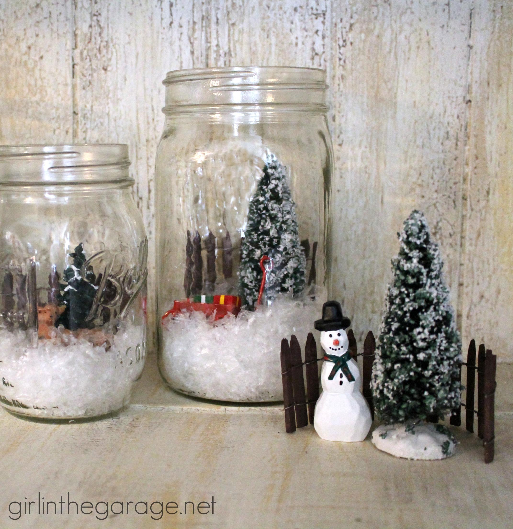 Winter scene in a mason jar girl the garage