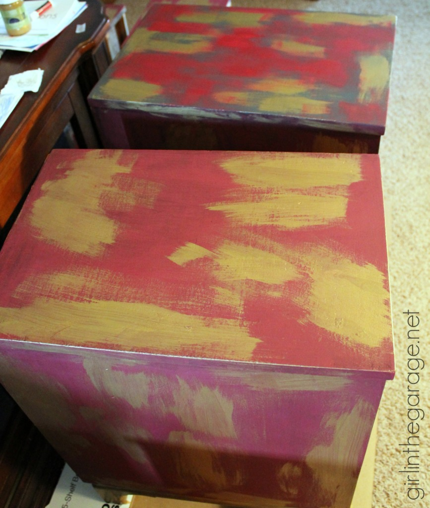 Antique Oriental nightstands get a makeover with Chalk Paint and metallic gold paint.  Themed Furniture Makeover Day (Red).  girlinthegarage.net