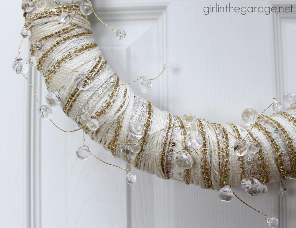 Easy DIY yarn wreath and foyer decorated for Christmas.  girlinthegarage.net