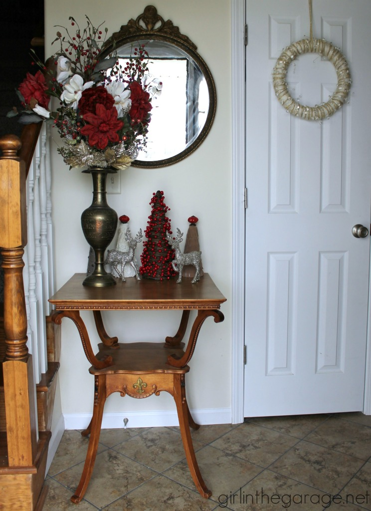 Easy DIY yarn wreath and foyer decorated for Christmas.  girlinthegarage.net