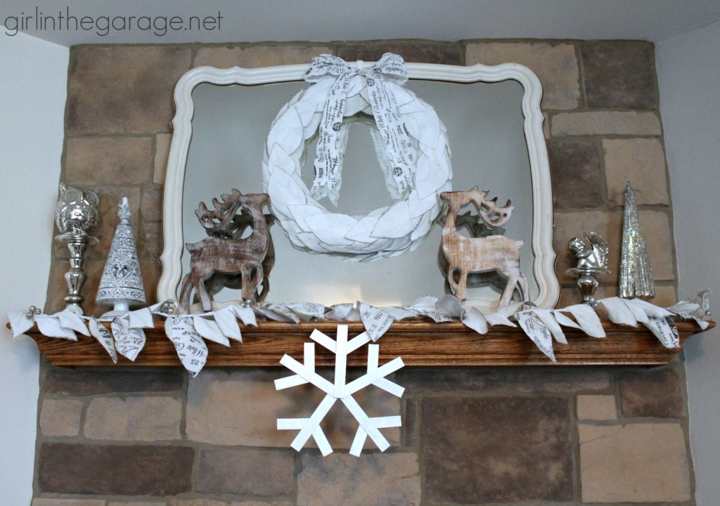 How to make your own winter decor snowflake craft with wood sticks, white paint, and Sparkle Mod Podge.  girlinthegarage.net
