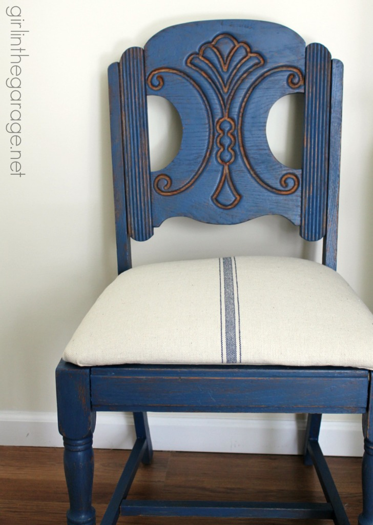 See how an outdated vintage chair got a French Country Chic makeover with new paint and grain sack fabric.  girlinthegarage.net