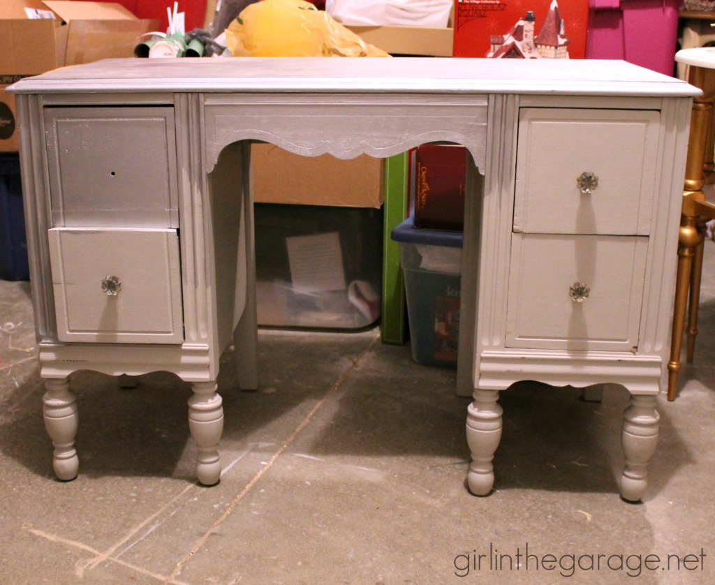 A vintage vanity gets a bright makeover for a little girl.  Custom pink color from Annie Sloan Chalk Paint.  girlinthegarage.net