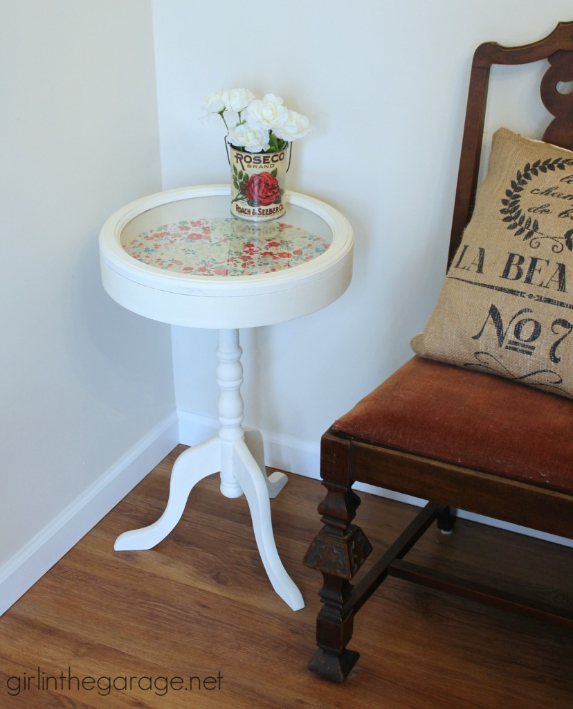 Add some personality to a plain table - paint it and decoupage pretty paper inside!   girlinthegarage.net