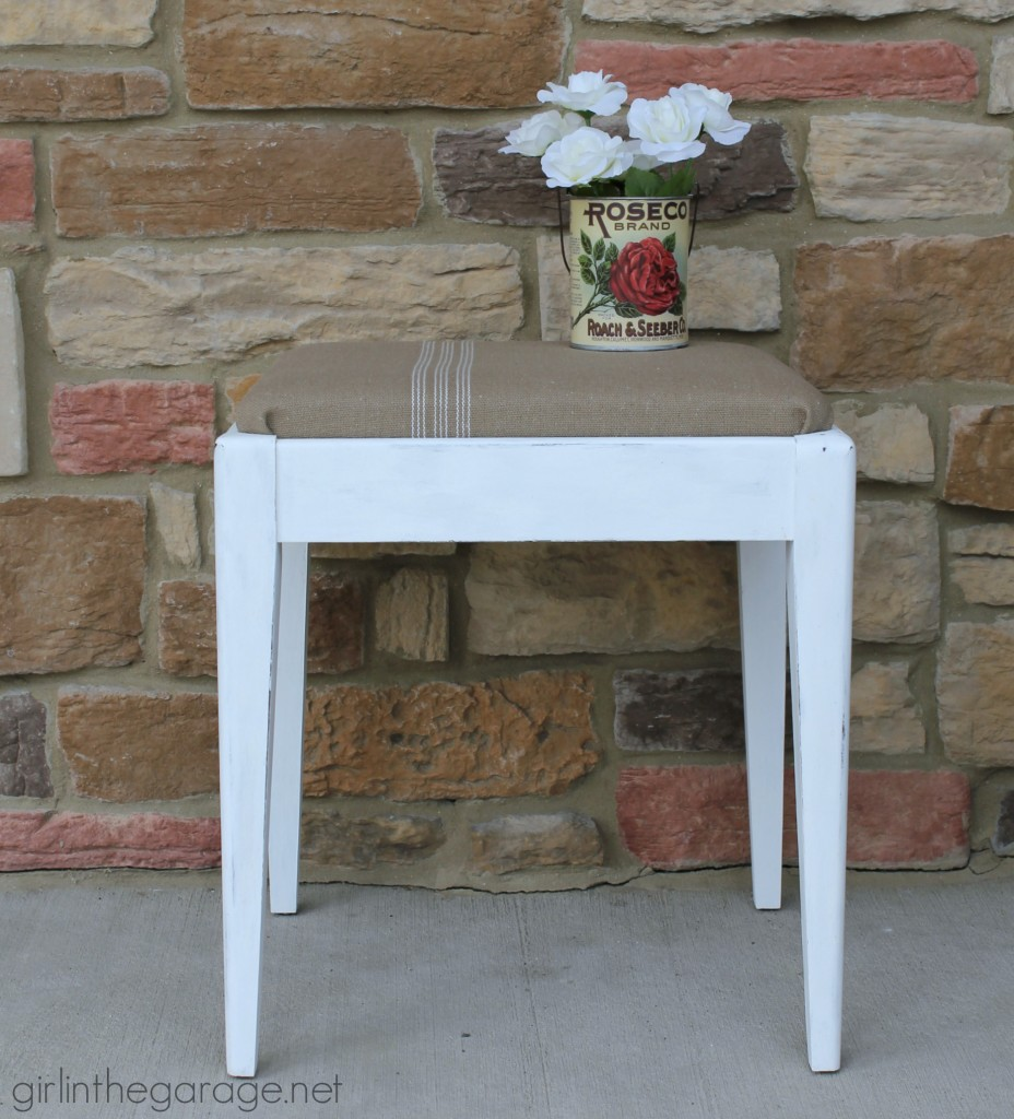See how a plain Goodwill stool was given a vintage farmhouse makeover.  girlinthegarage.net