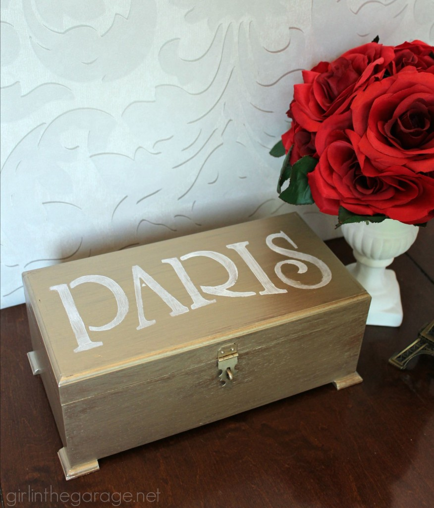 Metallic paint and a Paris stencil glam up a yard sale jewelry box.  girlinthegarage.net