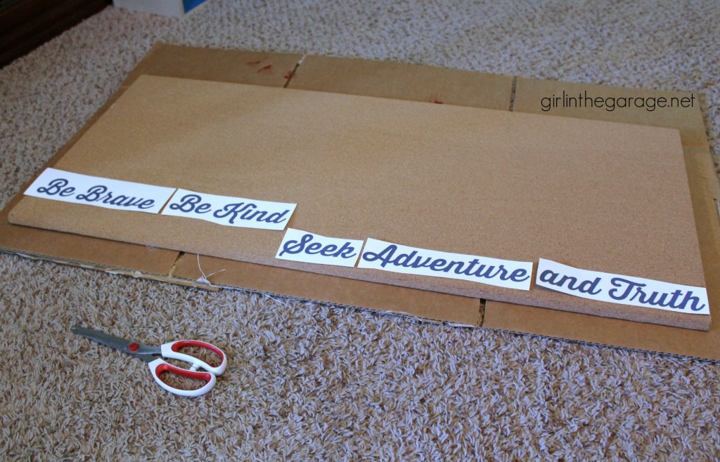 How to make an inexpensive DIY photo memo board with just a few supplies.  girlinthegarage.net