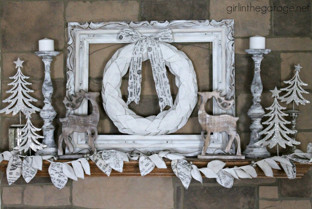 Christmas mantel decorated in white for a winter wonderland theme.