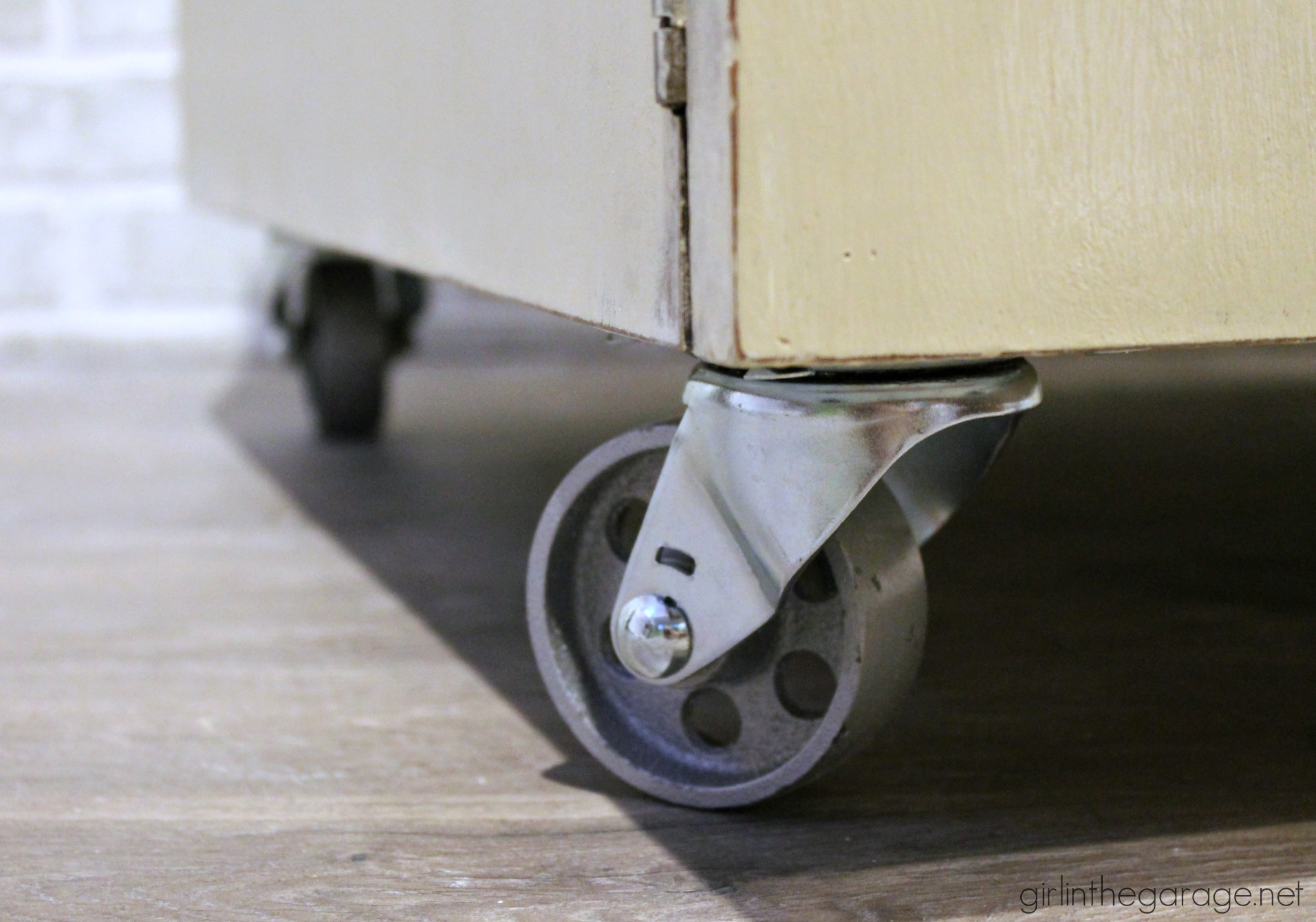 DIY Industrial Coffee Table Makeover with Casters and Repurposed Leather Belt Handle - Girl in the Garage