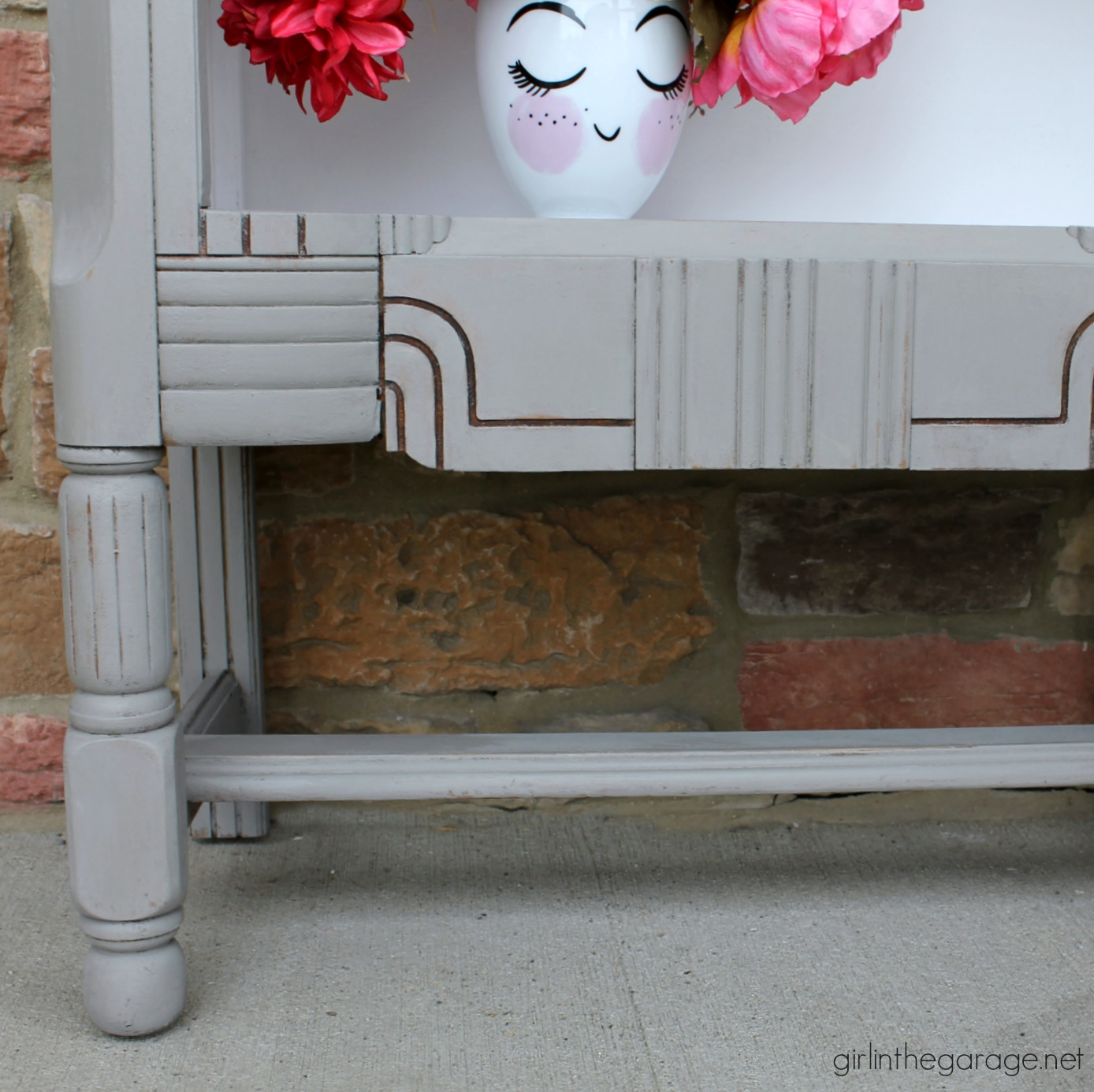 repurposed radio cabinet makeover girl in the garageÂ