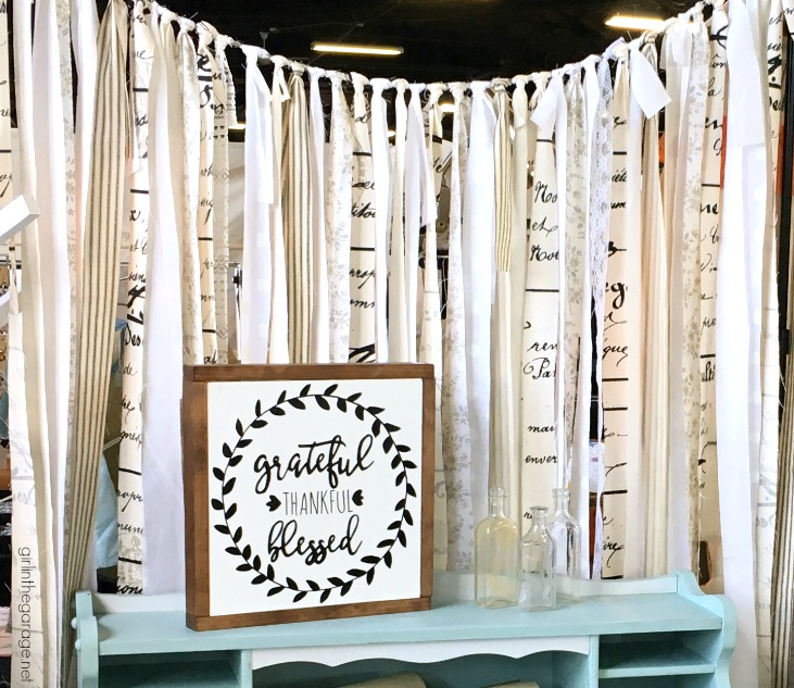 How to make an easy DIY fabric garland backdrop to make a stunning focal wall for parties, weddings, vintage markets, or use as home decor. By Girl in the Garage