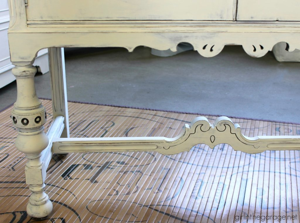 Antique sideboard makeover. How to paint a beautiful white distressed finish with Chalk Paint. By Girl in the Garage