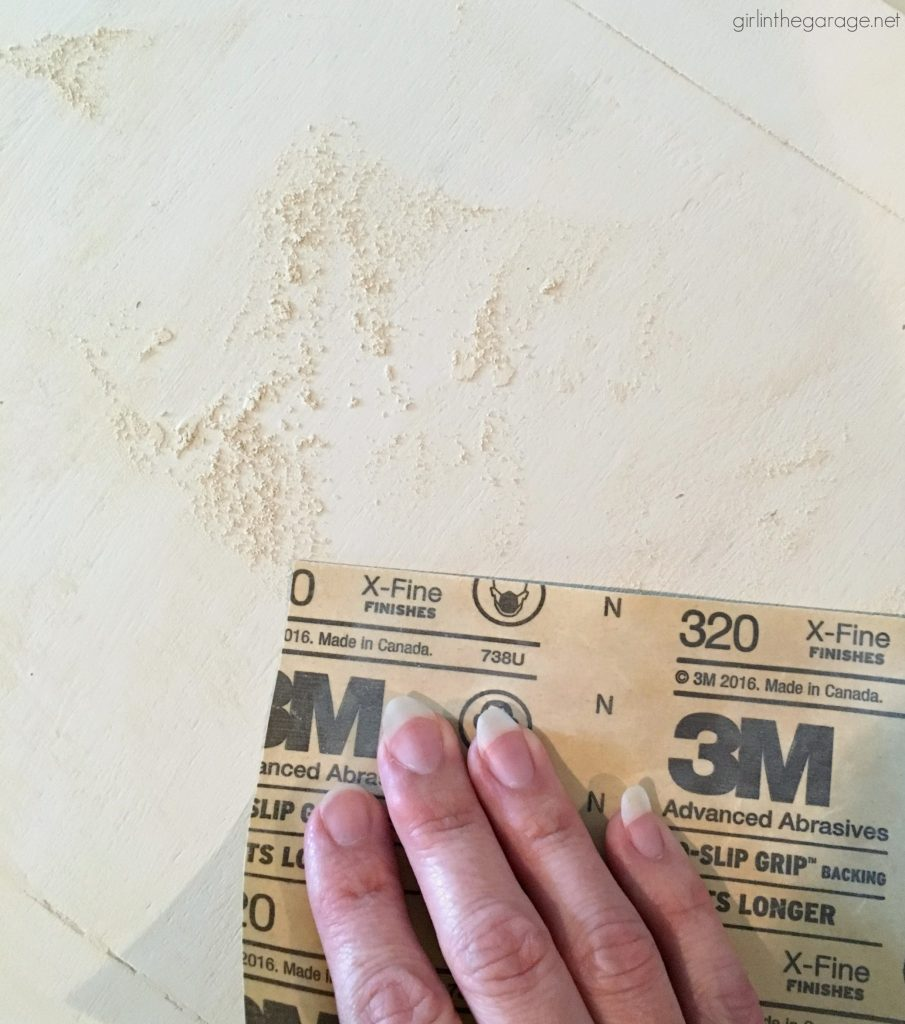 Sanding furniture with 320 grit sandpaper. Girl in the Garage