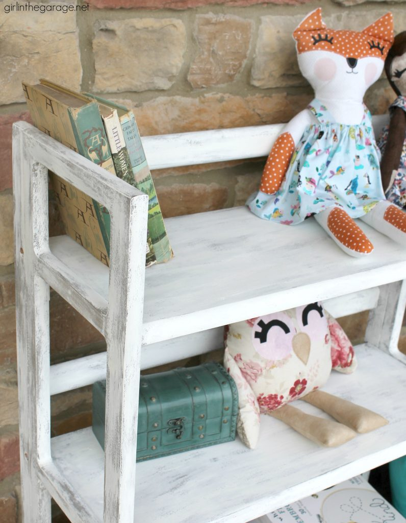 Craft fair necessity: A DIY painted folding bookcase - portable and sets up in seconds. Paint a folding bookcase to match your market booth's style. by Girl in the Garage