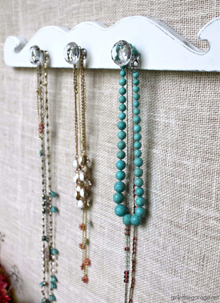 How to create an easy, stunning DIY necklace display with salvaged wood to organize your treasured jewelry. By Girl in the Garage
