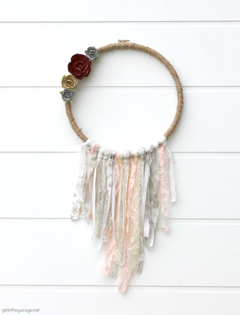 Huge fabric stash? Use your fabric scraps along with ribbon and lace to make a stunning DIY embroidery hoop wreath. Add some flowers for fun! DIY decor ideas by Girl in the Garage