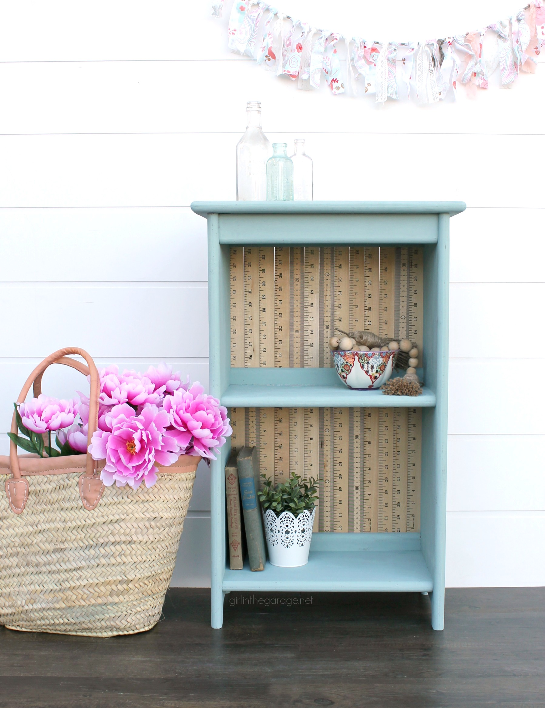 Give an old bookcase pizzazz with Chalk Paint and repurposed yardsticks. This easy painted furniture makeover idea oozes vintage charm. By Girl in the Garage