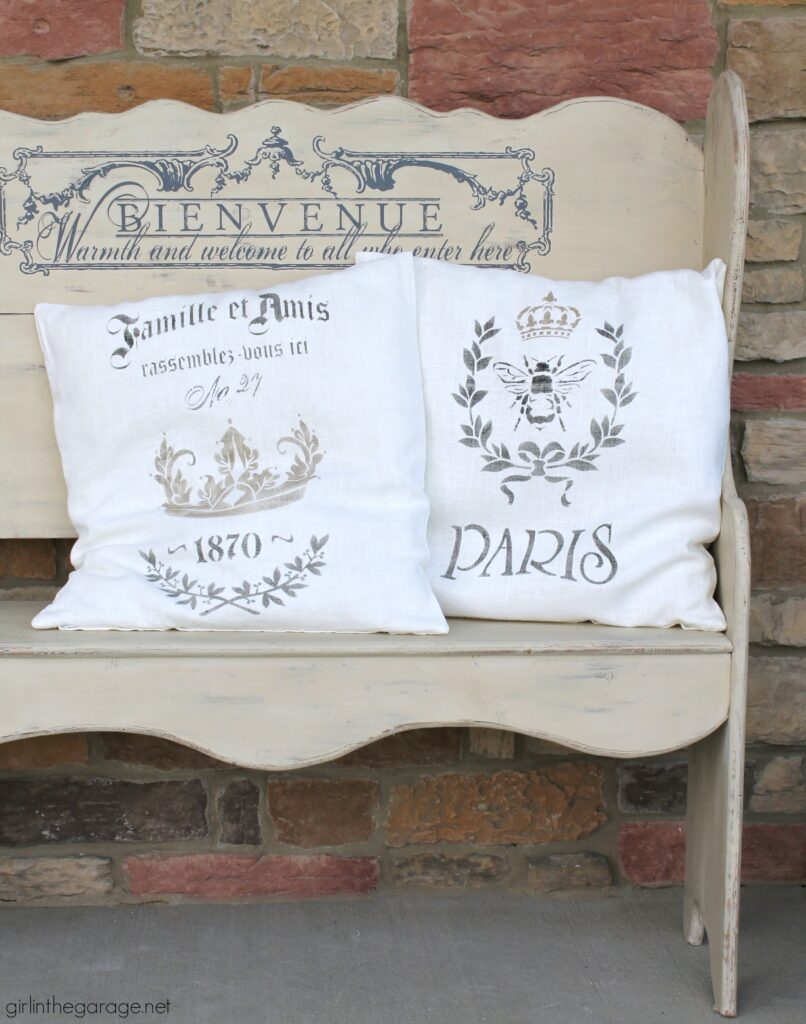 Make custom DIY home decor - learn how to stencil pillows as an IKEA hack. Gorgeous vintage inspired French throw pillows by Girl in the Garage.