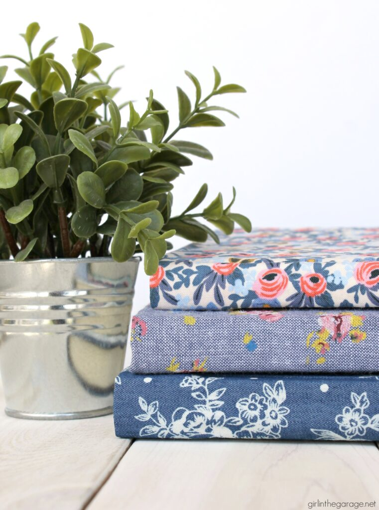 Learn how to decoupage fabric onto books and create gorgeous budget-friendly DIY home decor with this step by step tutorial from Girl in the Garage.