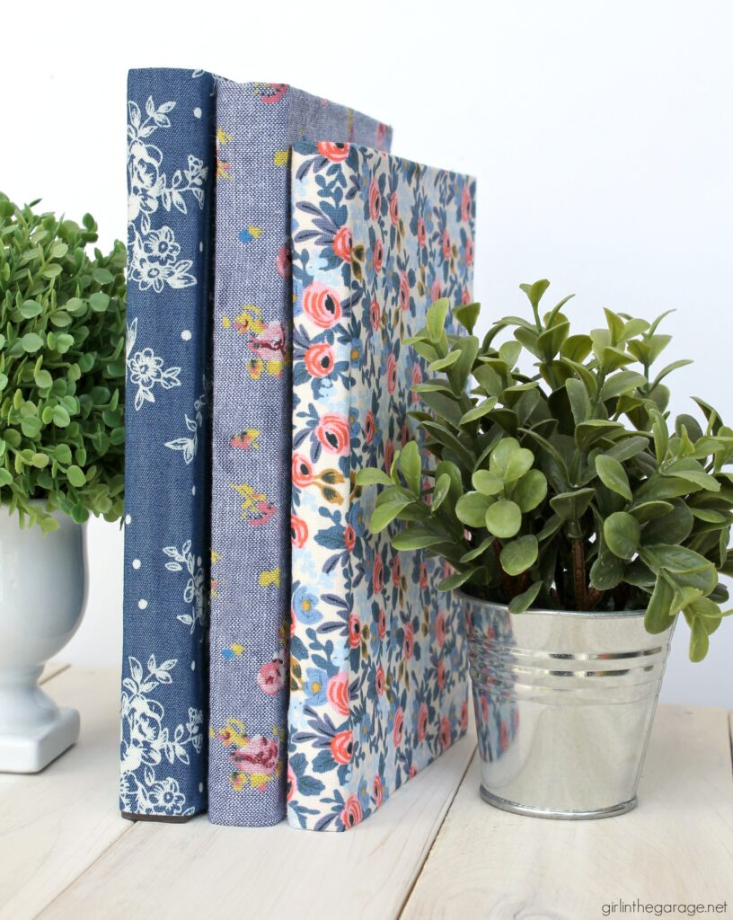How to decoupage fabric onto books for stunning DIY home decor - by Girl in the Garage