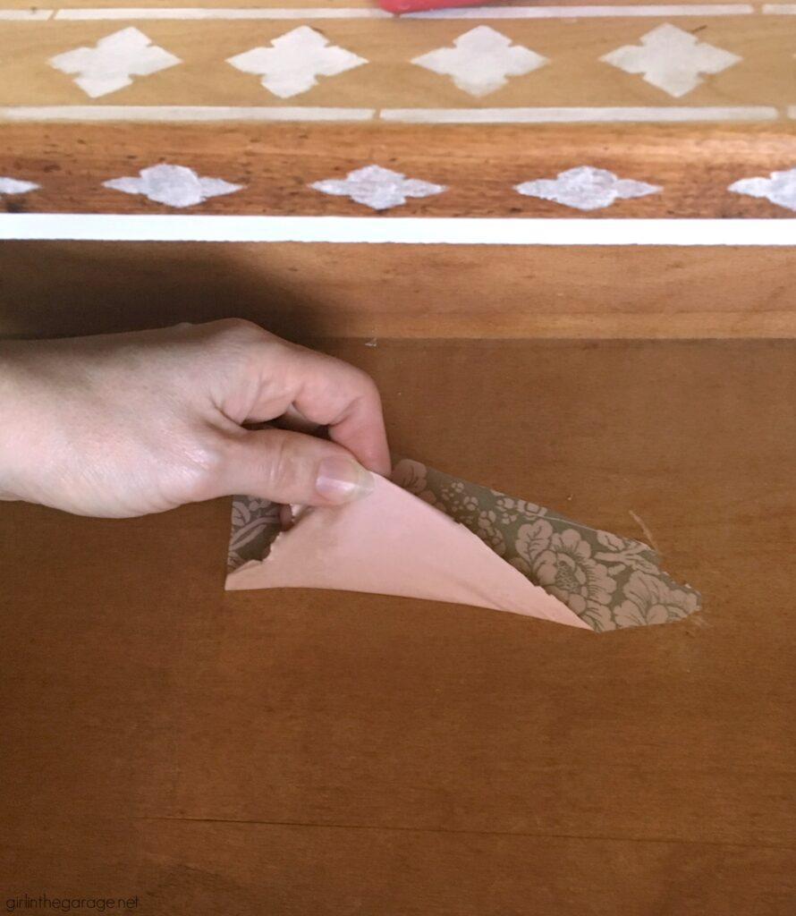 Do your drawers have old contact paper stuck inside? Discover how to remove contact paper the easy way. DIY painted furniture ideas by Girl in the Garage