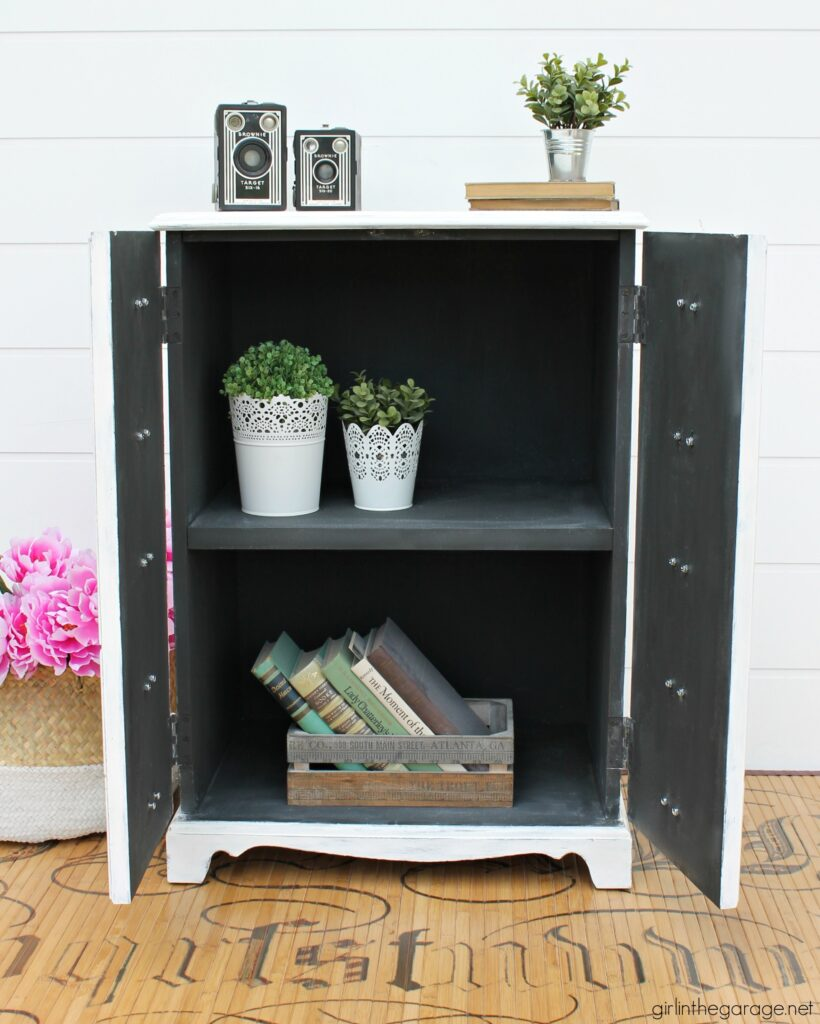 Transform plain furniture into a chic DIY apothecary cabinet! Learn how a curbside castoff was given vintage farmhouse charm with faux panels and label cup pulls. Painted furniture ideas by Girl in the Garage