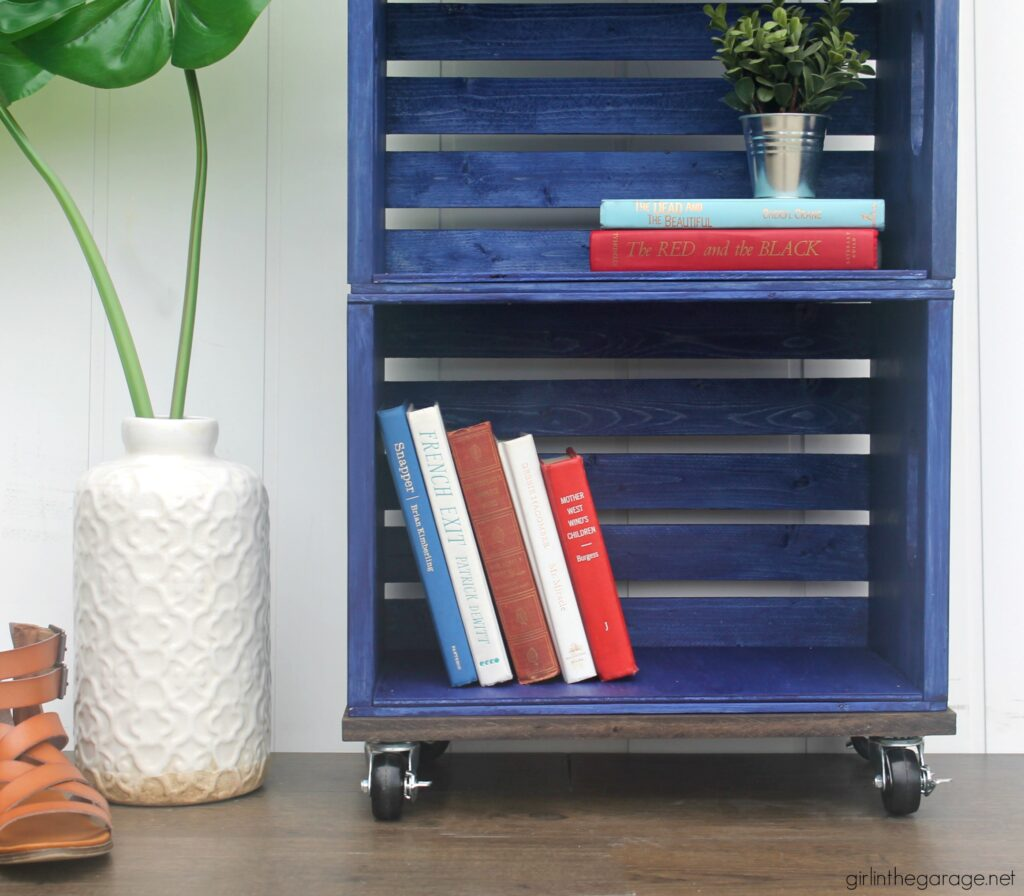 How to build a wooden crate bookshelf and properly prepare, stain, and protect it with Minwax products. DIY makeover ideas by Girl in the Garage. #ad
