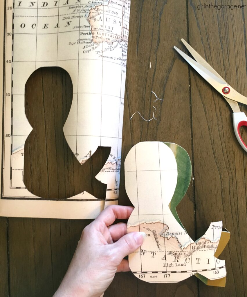 How to Decoupage Wooden Letters. Save money with these clever thrifted home decor ideas by Girl in the Garage