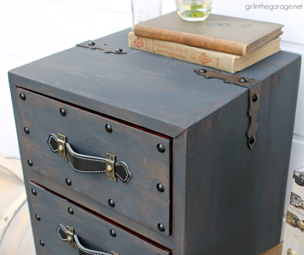 Create an antique steamer trunk with Chalk Paint and decorative accessories - this painted trunk nightstand is stunning industrial decor. By Girl in the Garage